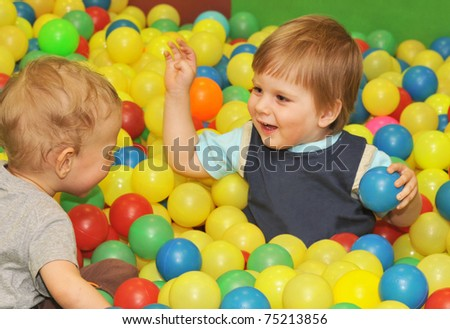 happy kids playing with colored balls
