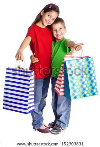 Happy kids standing with shopping bags, isolated on white