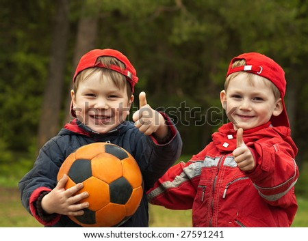Happy kids with a ball