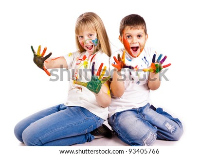 Happy kids with hands painted in colorful paints over white background