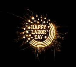 Happy Labor Day greeting done using sparklers on black background with copy space.