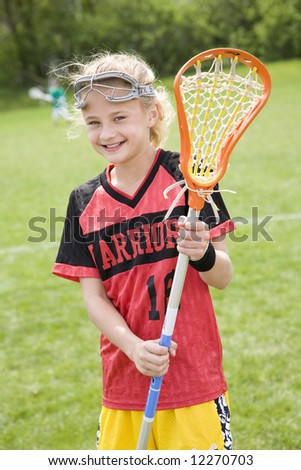 Happy lacrosse player with her stick