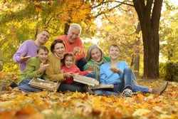 Happy large family picnic in the woods