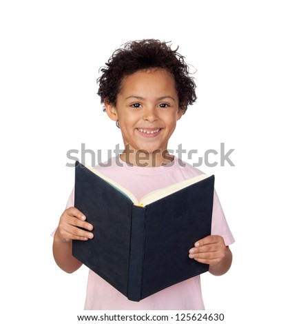 Happy latin child with a book reading isolated on white background