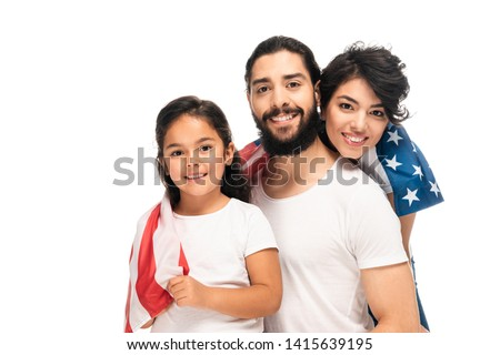 happy latin family smiling while holding american flag isolated on white
