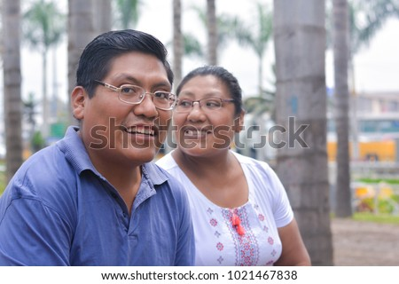 Happy latin people wearing glasses in the summer park. #1021467838