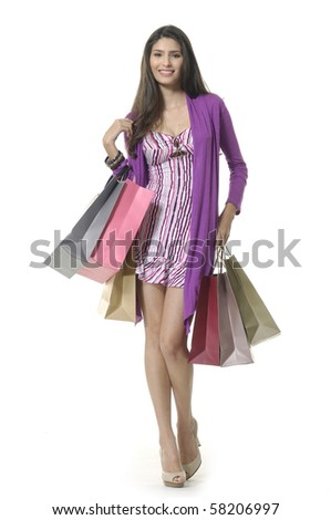 happy laughing adult girl with shopping bags