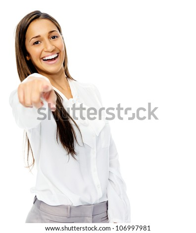 Happy laughing businesswoman pointing towards camera. Isolated on white background.