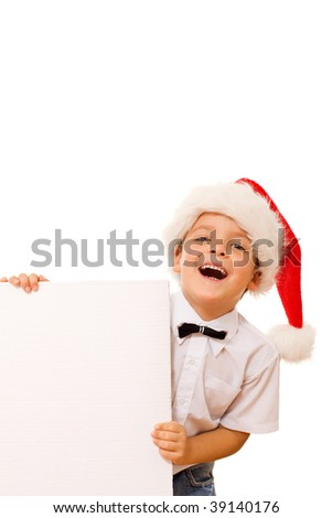 Happy laughing christmas hat boy with blank cardboard for your message - isolated