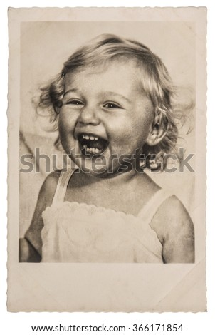 Happy Laughing Little Baby Girl. Vintage picture with original film grain and blur
