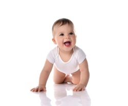 Happy laughing screaming toddler baby in diaper and white bodysuit is crawling on all fours looking at upper corner over white background. Happy infancy and babyhood concept
