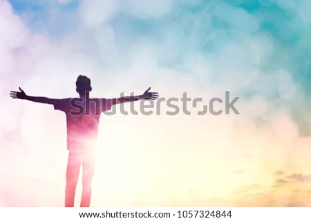 Happy leader man rise hand on morning sun light view. Christian motivation inspiration confide God on good friday background concept for feel self confidence successful healed wellbeing, dream like.