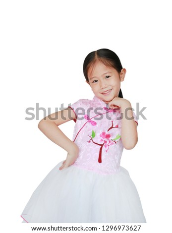 26dbf58a7be0d Happy little Asian child girl wearing pink Tradition Chinese dress for  Chinese New Year celebration isolated