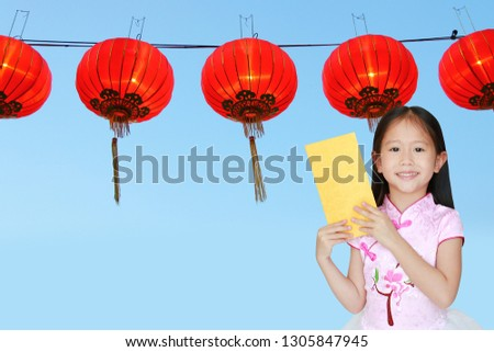 5f5b8b1b5 Happy little Asian child girl wearing pink traditional cheongsam dress  smiling while receiving gold envelope packet