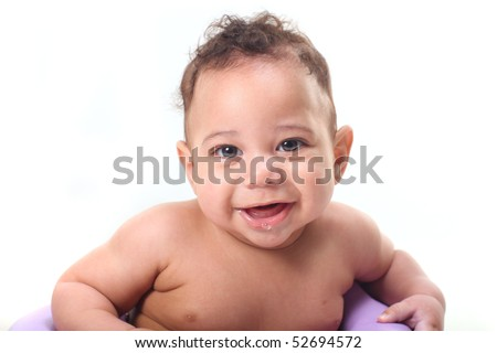 Happy Little Baby Boy Sitting up Smiling Against White Background