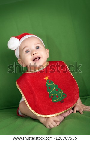 Happy little baby in Santa Hat and Christmas Bib