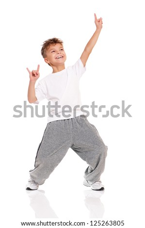 Happy little boy dancing isolated on white background Foto stock ©