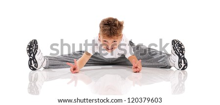 Happy little boy doing splits isolated on white background - stock photo