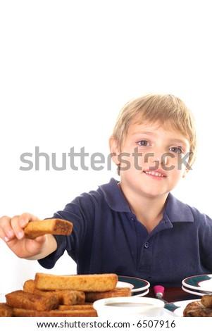 happy little boy eating breakfast