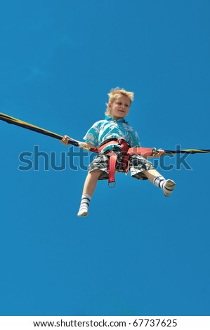 happy little boy flying over the blue sky