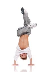 Happy little boy gymnastic acrobatics equilibrium posture isolated on white background