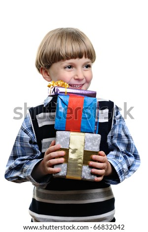 Happy little boy holding many present and gift boxes