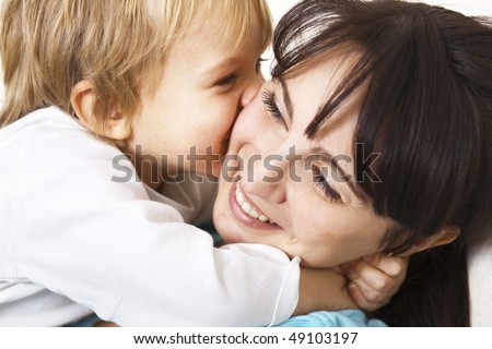 happy little boy hugging her mother; closeup