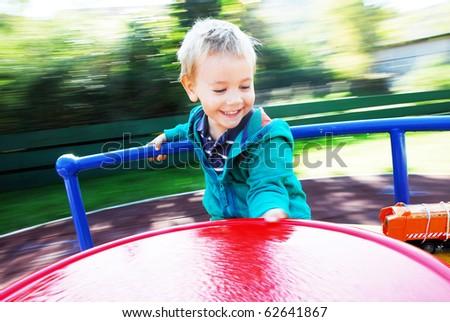 happy little boy on the carousel