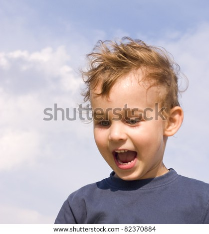 happy little boy on the sky background