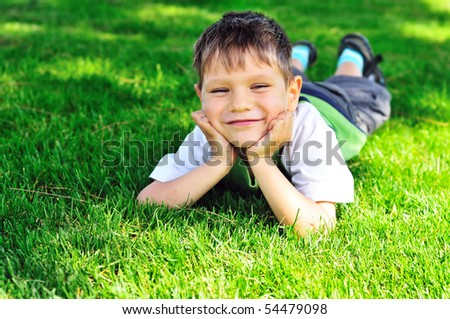 happy little boy on the sunny meadow