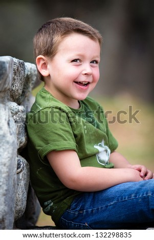 Happy little boy outdoors