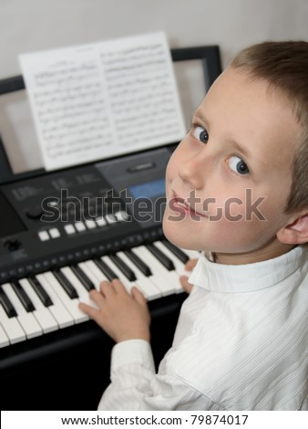 Happy little boy playing electric piano, keyboard. Educational illustration of music lessons.