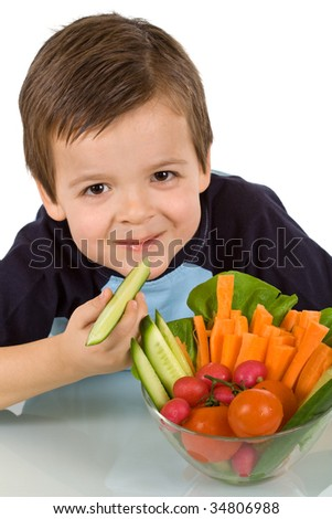 Happy little boy with a bowl of fresh sliced vegetables - isolated, closeup