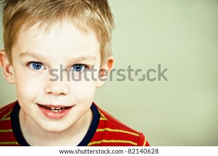 Happy little boy with blue eyes