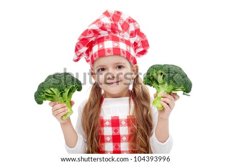 Happy little chef girl with hat and apron holding broccoli - isolated
