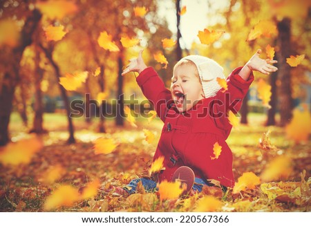 happy little child, baby girl laughing and playing in the autumn on the nature walk outdoors #220567366