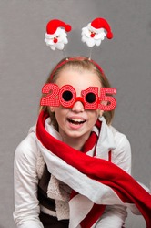 Happy little child girl  in the Christmas the symbols and glasses 2015 .