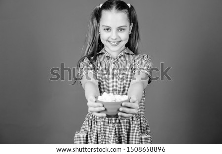 happy little child love sweets and treats. marshmallow. Candy shop. Small girl eat marshmallow. Dieting and calorie. Sweet tooth concept. Healthy food and dental care. Who cares about diet.