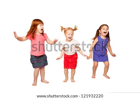 Happy little children dancing and jumping in air. Red-haired, blonde and brunette girls. Joyful party.  Isolated on white background.