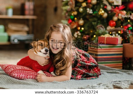 Happy Little girl and dog at Christmas