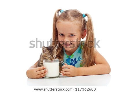 Happy little girl and her kitten sharing a cup of milk - isolated