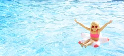 Happy little girl at the swimming pool. Summer vacation. Travel
