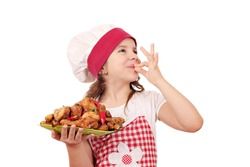 happy little girl cook with chicken drumstick and ok hand sign