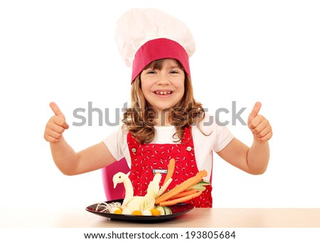 happy little girl cook with thumbs up and white swan decorated salad - stock photo