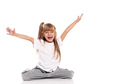Happy little girl doing gymnastics isolated on white background