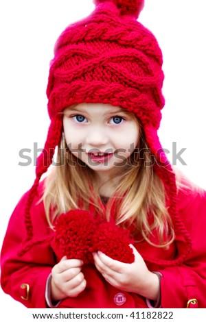 Happy little girl dressed for winter