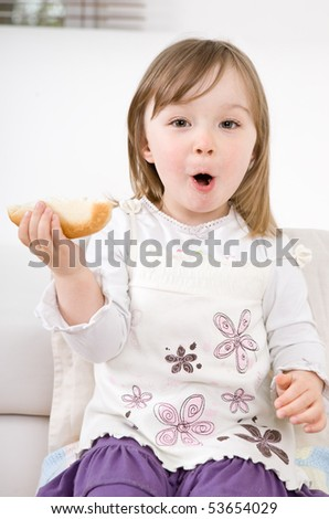 happy little girl eating