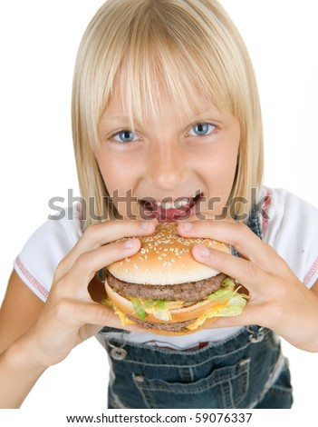 Happy Little Girl Eating Hamburger.