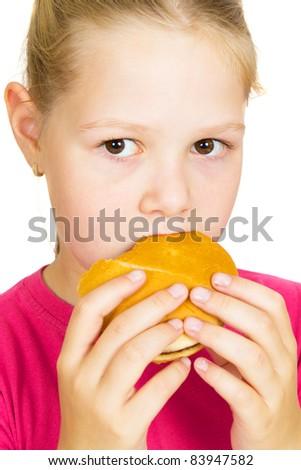 Happy Little Girl Eating Hamburger.