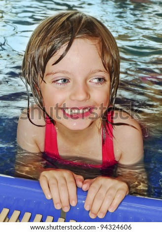 happy little girl five years old learning to swim